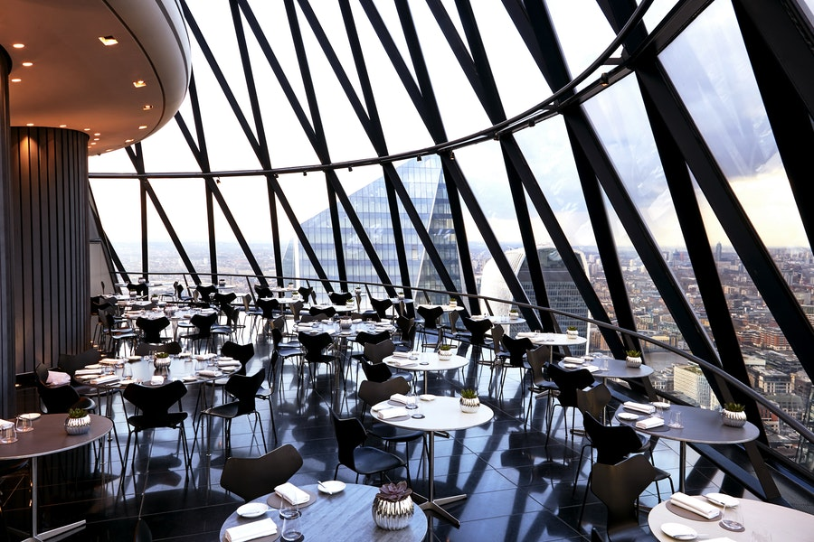 The Helix Bar - The Gherkin - Tables and a view from the window over London